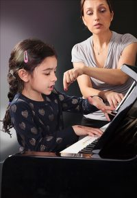 A child learns how to play a piano at Sparkling Art Piano School in Chicago